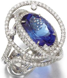 Tanzanite and diamond ring, Margherita Burgener.   Set to the centre with an oval tanzanite stated to weigh 11.97 carats, highlighted with lines of brilliant-cut diamonds, size M, Italian assay marks, numbered, signed Margherita Burgener, case.
