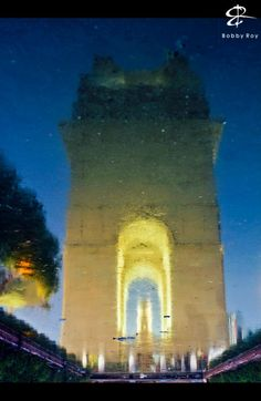 A reflection of India Gate in the shallow waters- by Bobby Roy