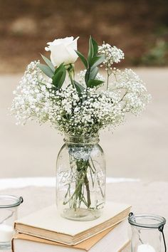 Baby's breath and roses in a mason jar—a simple, affordable wedding centerpiece