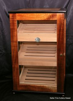Custom Order: Humidors -- Our custom Hawaiian curly koa humidors can be ordered to meet any interior or exterior dimensions. Available in either small box style or large glass display, our humidors offer handsome storage for personal collections or retail display of fine cigars.