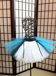 This lovely and unique princess tutu will make your little one feel very special when she wears it for dress up, birthday party, or as a unique little outfit for any ocassion. These tutus can be made in any size ... ALICE IN WONDERLAND tutu I HAVE A MATCHING ALICE IN WONDERLAND TABLE TUTU SKIRT! I can also accommodate large quantity orders for birthday parties or other events and will give bulk discounts. All tutus are made to order FREE SHIPPING!!!