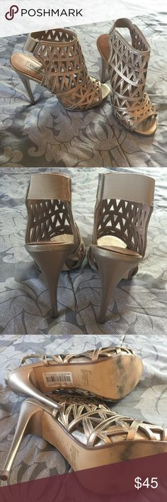 Gold caged heels Super sexy and fun caged heels. Used once for a wedding and for work. Great condition except for some light wear. See pictures. Nothing too noticeable. They go with everything! A cute dress, nice outfit for work or with a cute pair of skinny jeans with a white tank. Steve Madden Shoes Heels