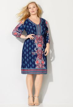 Shop trendy and feminine 70s inspired designs for spring like our plus size Baroque Border Peasant Dress available online at avenue.com. Avenue Store