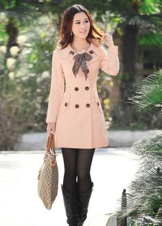 Pink coat black tights.