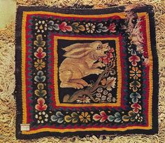 3rd - 4th Century AD: Hare. Rectangular tapestry-woven panel. Wool and linen. Multicolored border with a surround of natural colored, long-threaded looped weave. Egyptian, from Faiyum. Musee Historique des Tissus, Lyons.