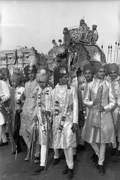 The Maharadjah of Baria arrives on an elephant, escorted by his cousins, to marry the Maharadjah of Jaipur's daughter, Rajasthan, Jaipur, India, 1948. Photograph by Henri Cartier-Bresson. In honor of Cartier-Bresson's birthday, click-through for a slideshow of his work: http://nyr.kr/R0WkpT