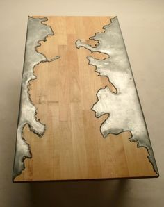 The beautiful freeform metal inset in this wood table looks geographic. Wood and Steel Table Unique Furniture, Wood Furniture, Furniture Design, Furniture Stores, Outdoor Furniture, Cheap Furniture, Metallic Furniture, Furniture Dolly, Furniture Movers