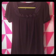 Black top with square detail. Loose fitting black blouse with square detail. Cap sleeves. Very comfy- yet stylish! Like new. H&M Tops Blouses
