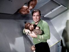 https://flic.kr/p/85H2Nw | Falling Tribbles | Speaks for itself. One of Shatner's better expressions during the sequence. Fortunately his hair piece stayed on!   I have read somewhere that you can buy a fairly inexpensive roundtrip ticket on Priceline to Space Station K7, and of course while there you can partake of one of their famous all you can eat buffets featuring both Earther and Klingon dishes. If you do go be sure to not pack only wrap around style green tunics to wear as over…