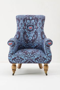 this fabric is awesome!  chair is a bit too much, but rip me off that fabric!