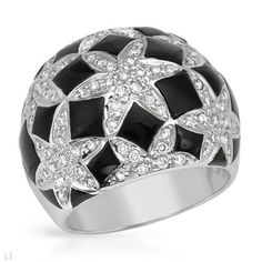 Cocktail ring with diamonds and onyxes in white gold.