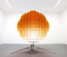 vincent leroy's sunrise installation rotates to display a globe of blurry light