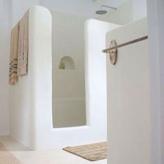 Moroccan style bathroom.  Smooth and cave-like surfaces, from a country of elaborate style