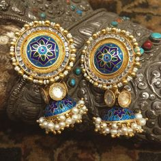Traditional silver gold-plated floral blue enamelled earrings. To place an order email info@amrapalijewels.com or visit your nearest #Amrapali store.