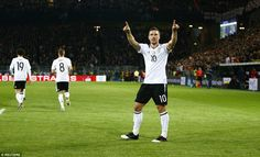 The Galatasaray forward points towards the home fans after giving Germany the lead over England on Wednesday night
