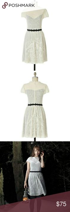 """*SALE* Anthropologie Lantern's Glow Dress XS A lacy white overlay, patterned with nocturnal birds, illuminates a black jersey lining and grosgrain waistband. By liaMolly. Keyhole nape  Cotton; cotton lining  Hand wash  Stunning ivory crochet dress with black lining. Bird motif on the skirt. Hard to find dress for good reason. Excellent preloved condition. Hesitant to let this go but my waist is a little too short for the dress :(  Approx measurements:  Bust: 12.5""""  Waist: 12.25""""  Length: 37""""…"""
