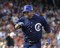David DeJesus sports his 1912 throwback uniform as he runs the bases after his home run against the Giants