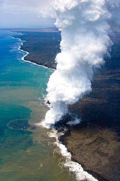 Lava tube into ocean, Hawaii.