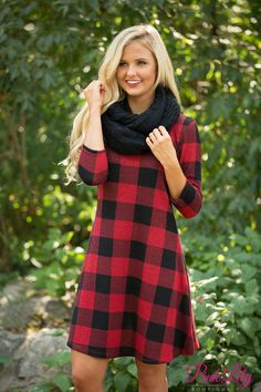 This gorgeous little plaid dress is sure to make a statement all season long!
