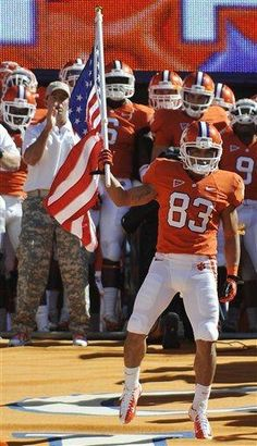 Clemson's own Daniel Rodriguez, Army veteran and recipient of the Purple Heart and Bronze star, leading the team down the hill on military appreciation day against Virginia Tech.