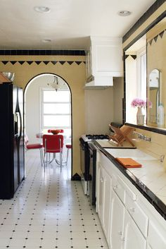 vintage yellow and black tile in a galley kitchen