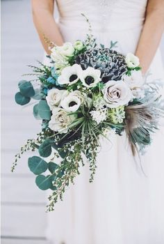LOVE this bouquet!! Minus the feather and minus the cabbage as the main flower centerpiece. Replace that with something else and this would be my dream with more iris/blue thistle accents.