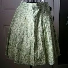 New York & Company sz 12 Floral Skirt Full Skirt, floral design with green, & yellow flowers with black detail. Very lightweight! Not lined,  zips at the side  Great condition from a smoke and pet free home  Please feel free to ask questions, or request additional photos  Don't forget to bundle for discounts! New York & Company Skirts A-Line or Full