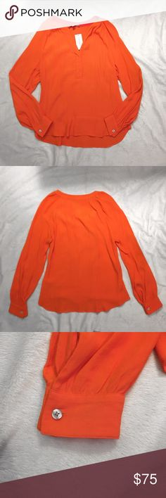 New!! Orange banana republic blouse Beautiful Banana Republic blouse!! Has a pretty v neck and cuffed sleeves. There's a hidden button that can be undone to make a deeper v neck. Material: 100% viscose Banana Republic Tops Blouses