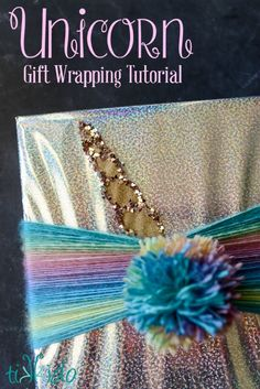 Quick and easy unicorn themed gift wrapping tutorial using iridescent wrapping paper and rainbow variegated yarn.