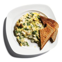 Egg-White Frittata with Feta, Spinach, and Mushrooms 2 egg whites 1 egg 1/2 cup chopped fresh spinach 1/2 cup chopped button mushrooms 1 oz feta cheese 1 tsp fresh cilantro 1 slice oat-bran bread 2 oz glass 100 percent pomegranate juice 6 oz water or seltzer    Total: 362 calories