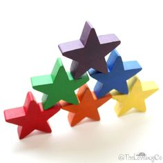 Star Stackers  A great game for preschool age kids to learn their colors. Balancing the stars on top of each other can increase fine motor skills, depth perception, hand-eye coordination, and spatial awareness. . . . . #shoptlc #kids #playtime #playtimematters #woodtoys #woodentoys #montessori #rainbow #kidstoys #natural #rainbow #letthembelittle #preschool #kinderkids #livecolorfully #learning #stars #stacking
