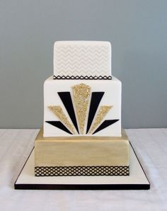 modern - Top tier is covered in shorting and then I used a zig-zag stencil with gold luster dust. Middle tier has real gold flecks (I cut the shapes and allowed a day to dry). 1920s Wedding Cake, 1920s Cake, Square Wedding Cakes, White Wedding Cakes, Art Deco Wedding, Gatsby Wedding, Speakeasy Wedding, Trendy Wedding, Art Deco Cake