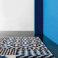 I have tiles in the bedroom which is cold under foot and I imagine I will freeze come winter. I have been thinking of layering different rugs I solve the problem...it could end up looking a lil like this