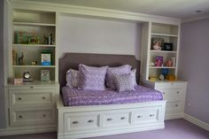 Post showing steps to build built in bookcases and day bed with trundle