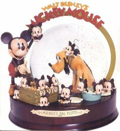Mickey Mouse and Pluto snow globe (Depicting the 1933 cartoon where Pluto must learn to share Mickey with a bunch of kittens).