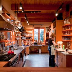 I love how she utilized the tall ceilings. Warm wood. Love the rafters.