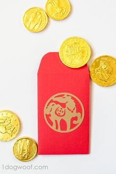 2017 is the year of the rooster. DIY red envelopes with chocolate coins for an easy kid-friendly celebration of Chinese New Year. www.1dogwoof.com