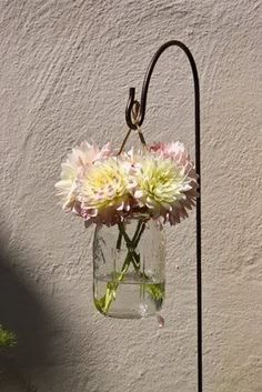 hanging lanterns using mason jars - with candles and no flowers. this would be pretty to set up down the aisle outside