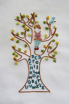 Cute embroidery: little girl in an alphabet tree