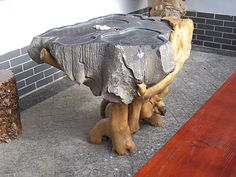 Chinese tea table, made from roots that rapped around a bolder.