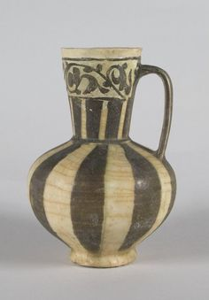 Jug, mid-12th century. Ceramic; transparent colorless glaze, black slip, white engobe, buff earthenware body, 6 3/4 x 4 1/2 in. (17.2 x 11.5 cm). Brooklyn Museum, Gift of the Ernest Erickson Foundation, Inc., 86.227.77. Creative Commons-BY (Photo: Brooklyn Museum, 86.227.77_PS5.jpg)