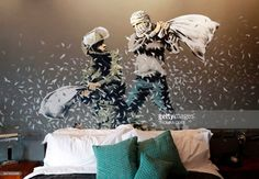A picture shows a bed and graffiti inside street artist Banksy's newly opened Walled Off hotel in the Israeli occupied West Bank town of Bethlehem, on March 3, 2017. Secretive British street artist Banksy opened a hotel next to Israels controversial separation wall in Bethlehem on Friday, his latest artwork in the Palestinian territories. COEX