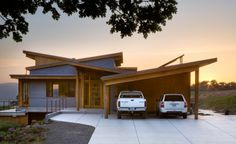 angled roof lines - but not a big fan of carports in front of houses. Carlos Delgado Architect