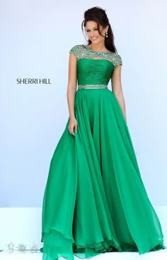 Looking like a goddess Sherri Hill 11181 is one of our season's favs! This dress has a trendy beaded cap sleeve neckline with a peep opening bust and rouched bodice. The cap sleeves are royally beaded with a princess pattern that joins in the center of the shoulder blades and reveals an opening in the back. A beaded waist band defines the waist while the flirty chiffon skirt will float down your lower half. A great choice for prom or pageants, this style is flattering and trendy! And not to…