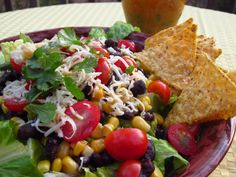 A colorful salad in celebration of spring including spicy black beans, tomatoes, corn, and cilantro.