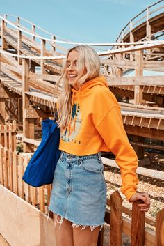 Denim skirt | Orange hoodie | Blue bag | Blonde hair | More on Fashionchick.nl