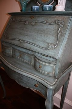 Get this look with Chalk Paint® by Annie Sloan in Louis Blue and Soft Dark Wax.