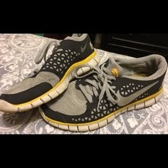 Dark gray and yellow Nike free runs Very comfortable Nike athletic shoes, size 9 Nike Shoes Athletic Shoes