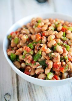 Black Eyed Pea Salad Recipe - red bell pepper, green pepper, scallions, garlic, olive oil, vinegar, parsley and black eye peas - GREAT side dish! We also like it as a dip. Make ahead of time and refrigerate - will last for several days. Recipe adapted from the famous Hattie B's Hot Chicken restaurant in Nashville, TN