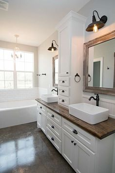 Easy Ways To Love Your Home; Farmhouse Bathroom Decor Ideas As far as home-improvement projects go, it's not the scale of the changes that you make. Wooden Bathroom Vanity, Modern Bathroom, Small Bathroom, Wood Counter Bathroom, Farmhouse Bathroom Sink, Bathroom Vanities, Vessel Sink Bathroom, Farm House Bathroom, Bathroom Countertops